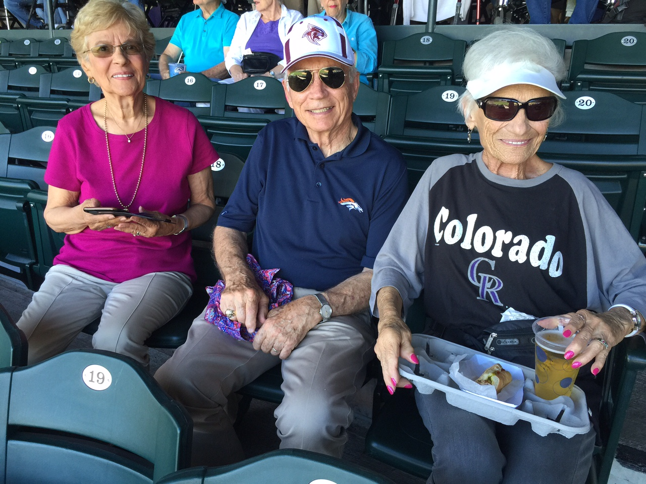 three residents at a rockies game